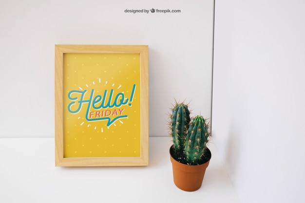 Photo frame mockup with cactus