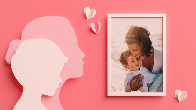 Photo frame mockup with mom and son silhouettes in papercut style for mother's day