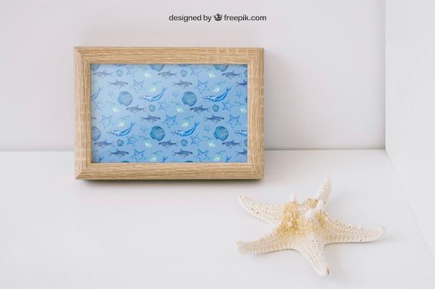 Photo frame mockup with starfish