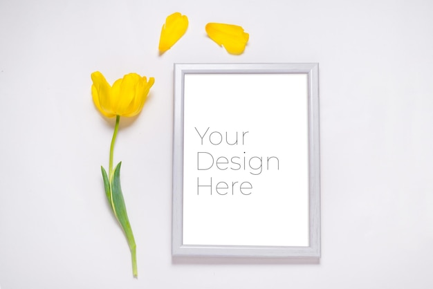 Photo frame with fresh yellow tulip