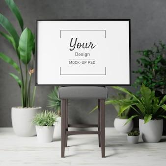 植物と椅子の上のフォトフレームのモックアップ