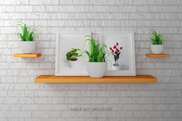植物と壁のフォトフレームまたはポスターのモックアップ