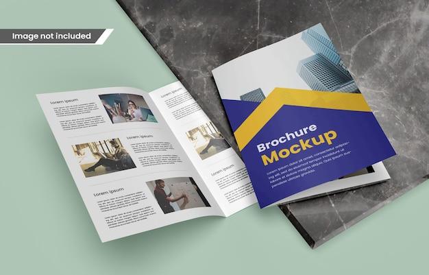 Photo realistic bifold brochure or magazine mockup