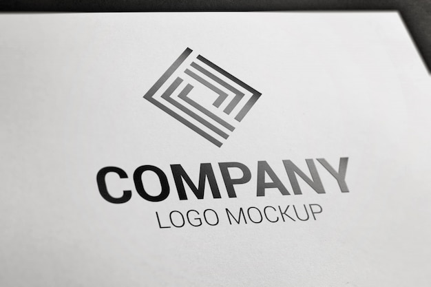 Photorealistic black logo mockup on white paper. Premium Psd