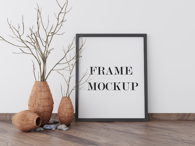 Picture frame mockup beside dry plant