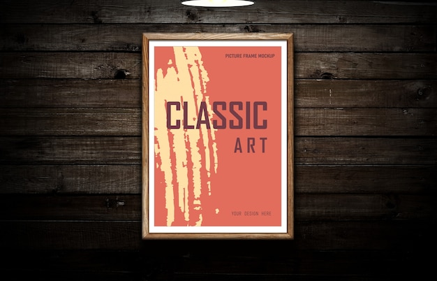 Picture frame mockup on black dark wooden wall background