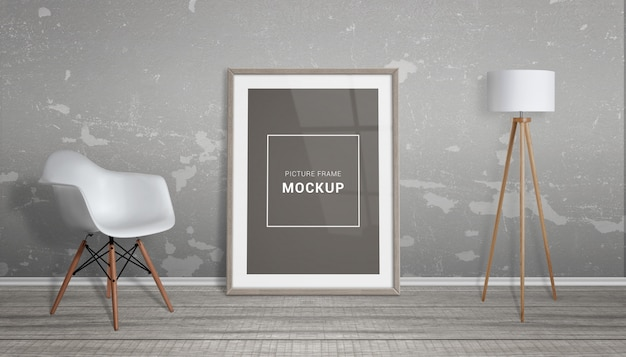 Picture frame mockup. the frame is leaning against the wall. chair and lamp beside. wooden floor.