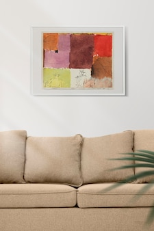 Picture frame mockup psd hanging in minimal living room home decor interior