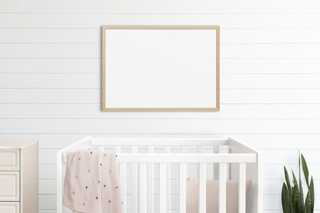 Picture frame mockup psd hanging in nursery room home decor interior