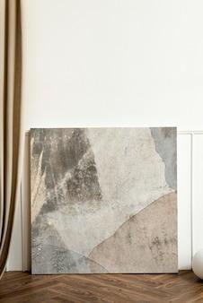 Mockup di cornice per foto psd appoggiato al muro dal design interno minimale