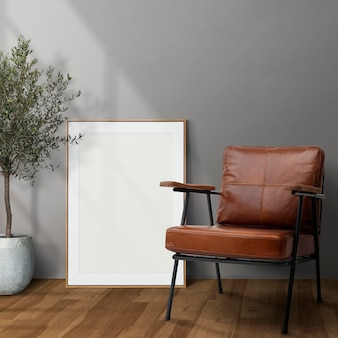 Picture frame mockup psd leaning in modern living room home decor interior