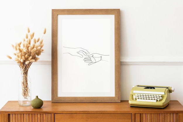 Picture frame mockup on a wooden sideboard table by a typewriter