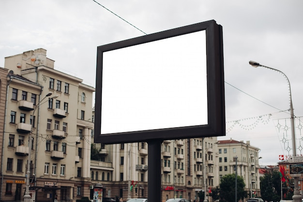 Picture of a large outdoor doard for displaying advertisements next to the avenue