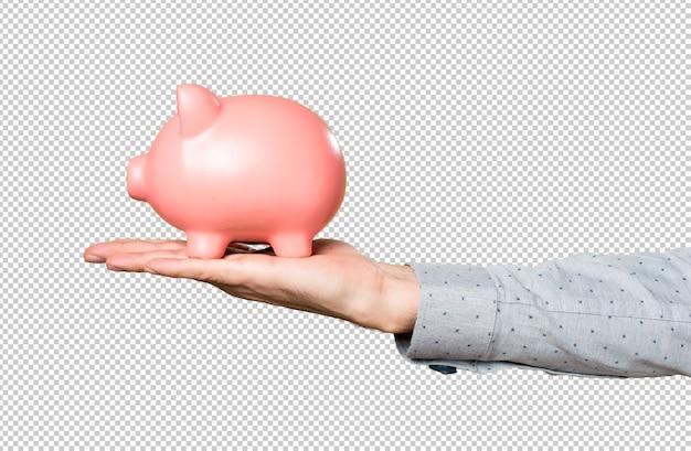 Рука человека держит проведение piggybank