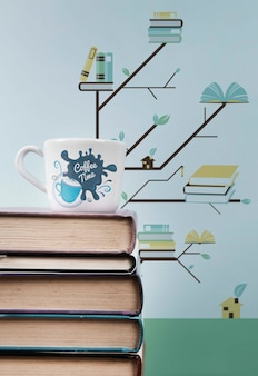 Pile of books close-up with cup of coffee