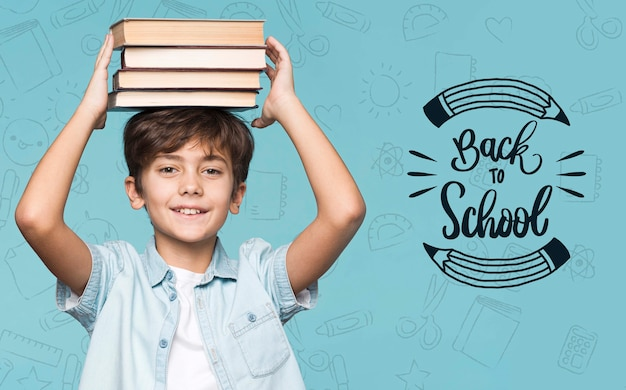 Pile of books young cute boy mock-up