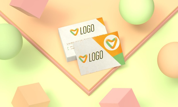 Pile of business cards on pastel color background and colored balls  mockup with a block of cards