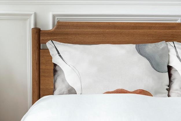 Pillowcase mockup psd in a wooden bed
