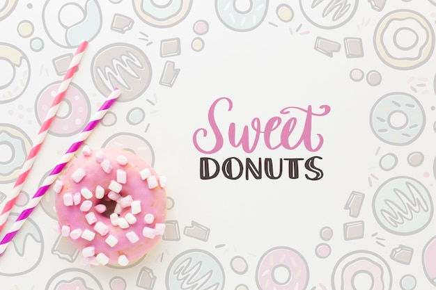 Pink donut with sweets and mock up