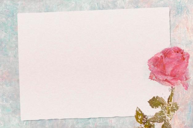 カードモックアップとピンクのバラの花
