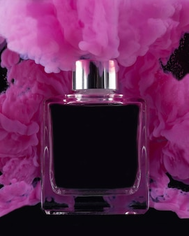 Pink smoke and perfume bottle