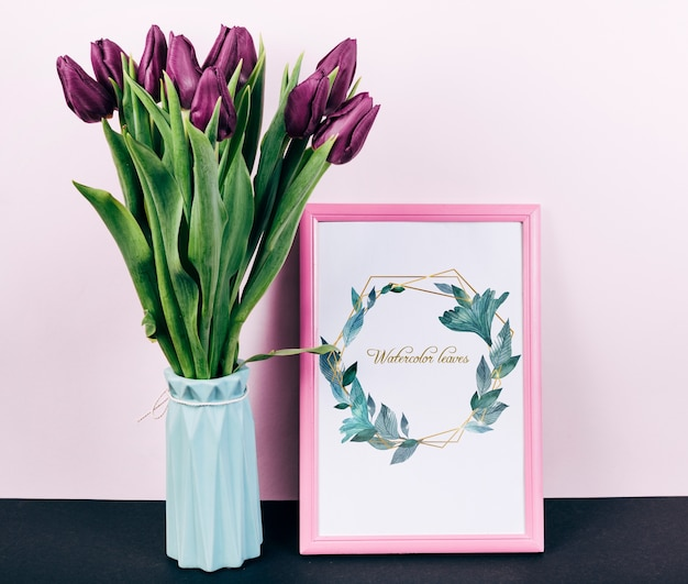 Pink spring frame mockup with bouquet of tulips