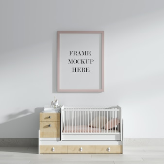 Pink wall frame mockup above baby bed