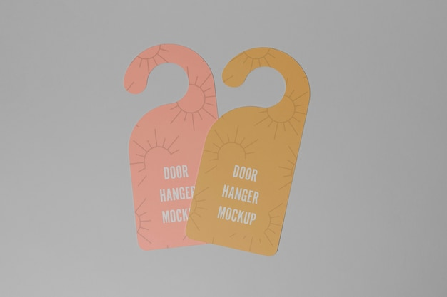 Pink and yellow door hangers for privacy