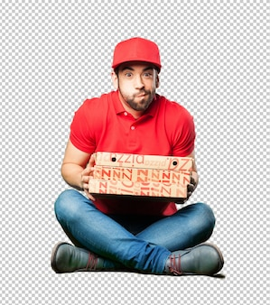 Pizza dealer sitting holding a pizza box