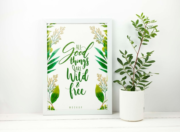 Plant next to frame mockup