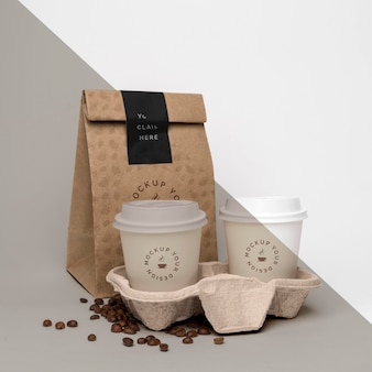 Plastic cup with coffee beans Free Psd