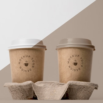 Plastic cup with coffee mock up in support