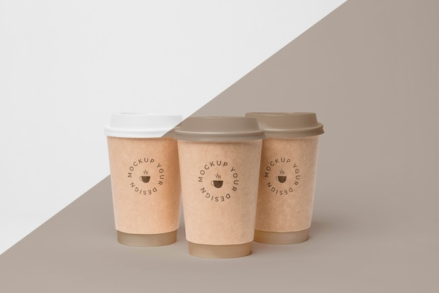 Plastic cup with coffee mock up on table