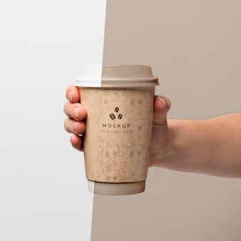 Plastic cup with coffee mock up