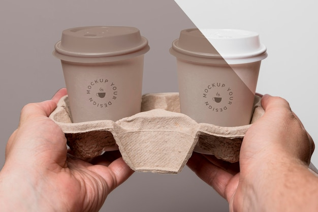 Plastic cups with coffee mock up in support