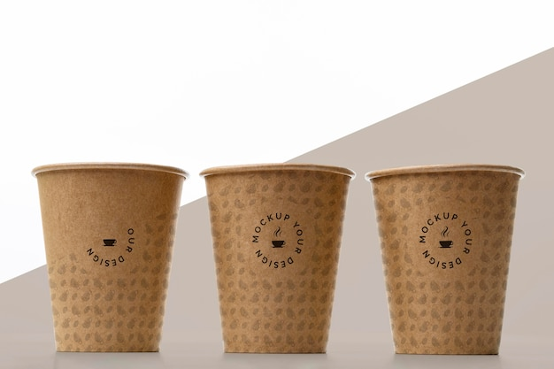 Plastic cups with coffee mock up on table