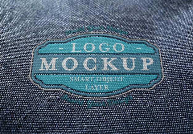 Plastic logo  on fabric texture