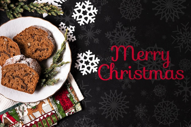 Plate with cookies baked on table for christmas