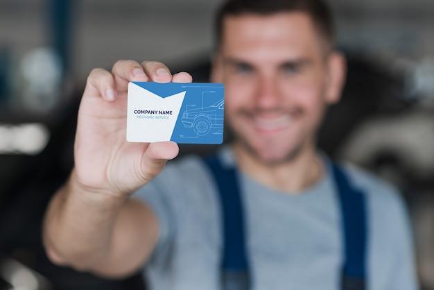 Plumber presenting business card