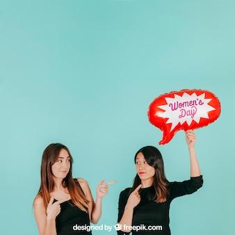 Pointing women with speech balloon mockup