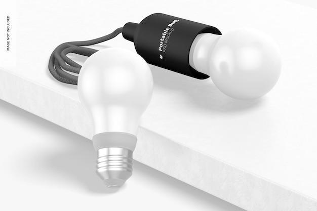 Mockup di lampadine portatili, appoggiate e lasciate cadere