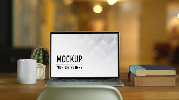 Portable laptop mockup in workspace with flowers