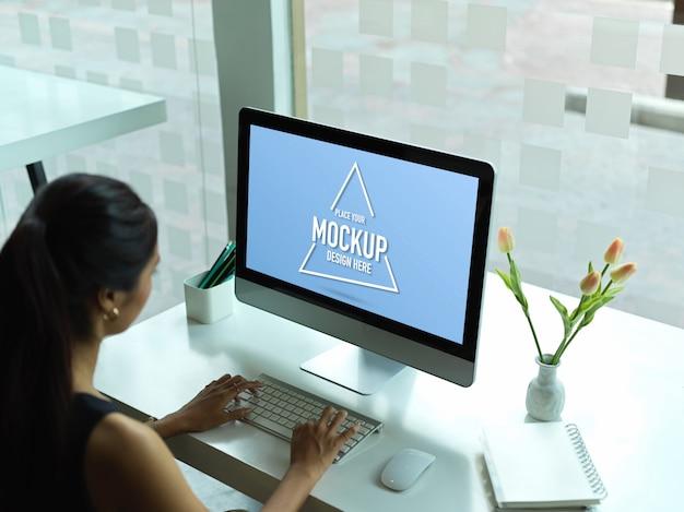 Portrait of female entrepreneur using computer mockup