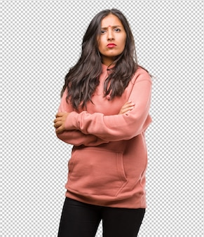 Portrait of fitness young indian woman crossing his arms, serious and imposing, feeling confident and showing power
