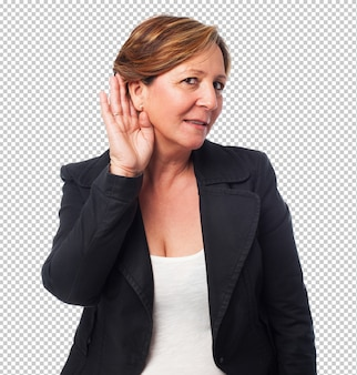 Portrait of a mature business woman listening to something