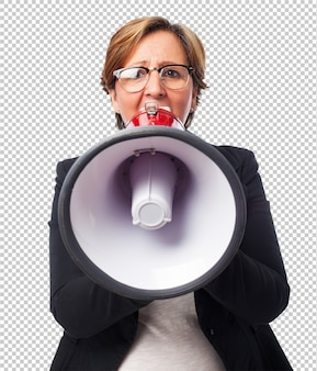Portrait of a mature business woman shouting with a megaphone