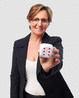 Portrait of a mature businesswoman holding a dice