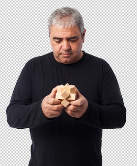 Portrait of a mature man trying to solve a puzzle