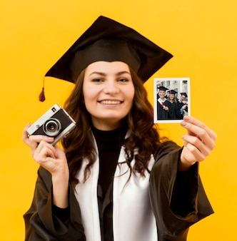 Portrait of student holding instant photo