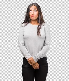 Portrait of young indian woman doubting and confused